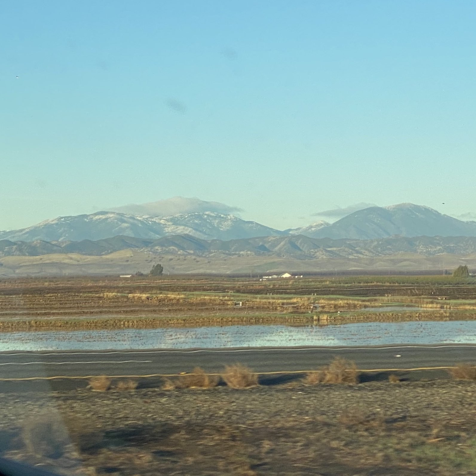 snowy mountain tops along a highway