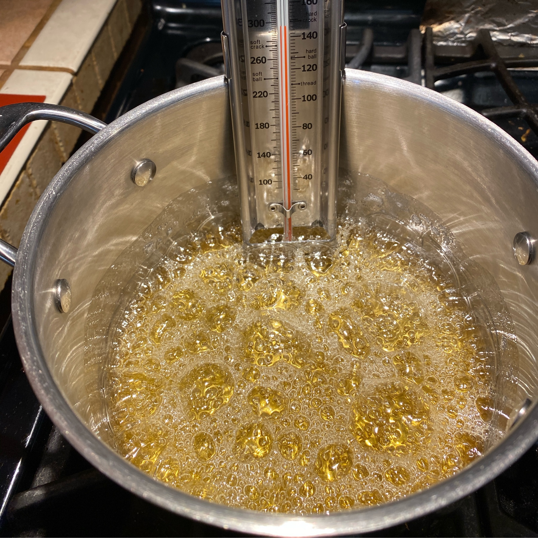 boling sugar mixture a gold color, almost 300F